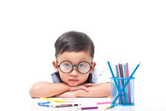 Cute boy drawing with colorful crayons Stock Images