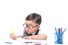 Cute boy drawing with colorful crayons Stock Photography
