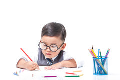 Cute boy drawing with colorful crayons Royalty Free Stock Image
