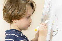 Cute boy drawing Stock Image