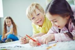 Cute boy drawing Royalty Free Stock Image