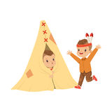 Cute boy dressed as an Indian playing with his friends in a tepee tent, kids having fun in a hut vector Illustration Royalty Free Stock Photo