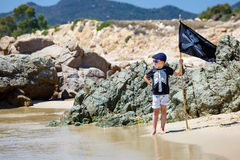 Cute boy dressed as pirate on beach Stock Photo