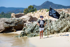 Cute boy dressed as pirate on tropical beach Royalty Free Stock Image