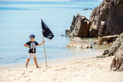 Cute boy dressed as pirate on tropical beach Stock Image