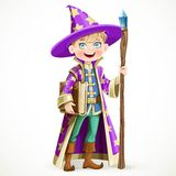 Cute boy dressed as a Wizard with the book and a magic staff Stock Image