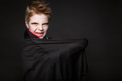 Cute boy dressed up as vampire for the halloween party Stock Images