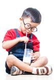 Cute boy drink milk Stock Photography
