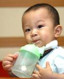Cute boy drinking Stock Image