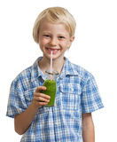 Cute boy drinking green smoothie Royalty Free Stock Photography