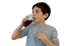 Cute boy drinking soft drink Stock Photos