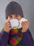 Cute boy drinking tea and wipes a nose with napkin Stock Image