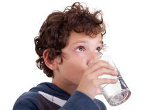 Cute boy drinking  water Stock Photo