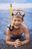 Cute boy driver on the beach Royalty Free Stock Photo