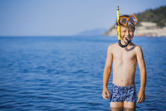 Cute boy driver on the beach Royalty Free Stock Images