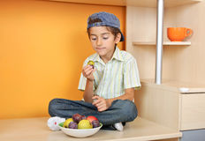 Cute boy eating fruits Royalty Free Stock Image