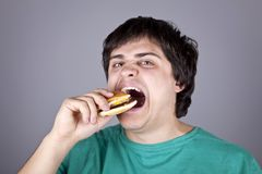 Cute boy eating hamburger. Stock Image