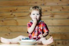 Cute boy eats cake Royalty Free Stock Image