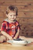 Cute boy eats cake Royalty Free Stock Photo