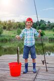 Cute boy enjoyed the fishing Stock Photo