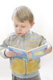 Cute Boy Enjoying a Book Royalty Free Stock Images