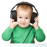 Cute boy enjoying music using headphones Royalty Free Stock Photo