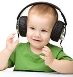 Cute boy enjoying music using headphones Stock Image