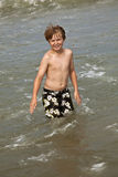 Cute boy enyoys the water in the ocean Stock Photography