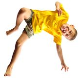 Cute boy exercising, dancing and jumping over white Royalty Free Stock Photo