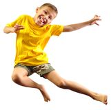 Cute boy exercising and jumping over white Stock Photo