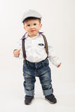 Cute boy with eyeglasses, suspenders and hat Royalty Free Stock Photos