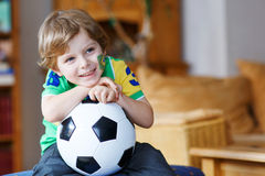 Cute boy fan having fun and happiness for football game Royalty Free Stock Images