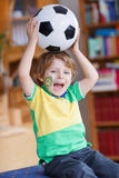 Cute boy fan having fun and happiness for football game Royalty Free Stock Photos