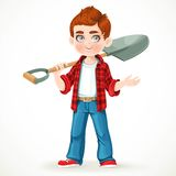 Cute boy farmer in jeans holding a shovel on his shoulder Royalty Free Stock Photography