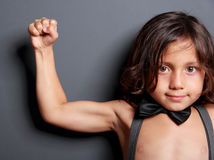 Cute boy feel fit and strong Royalty Free Stock Photos