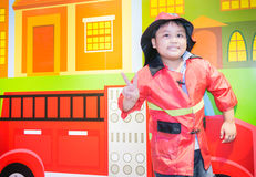 Cute boy firefighter Royalty Free Stock Photo