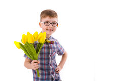 Cute boy five years, with bouquet of tulips Stock Photography