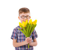 Cute boy five years, with a bouquet of tulips Stock Photos