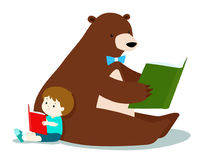 Cute boy and fluffy bear are reading a book . Royalty Free Stock Images