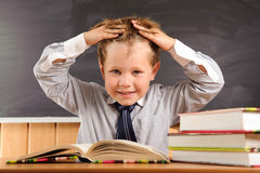 Cute boy fooling at the lesson Royalty Free Stock Images