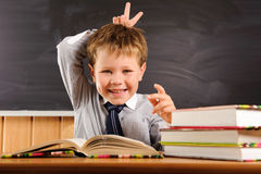 Cute boy fooling at the lesson Stock Photo