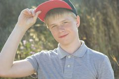 Cute boy with freckles on his face is wearing cap Royalty Free Stock Photo
