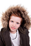 Cute boy with a furry hood Royalty Free Stock Image