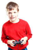 Cute boy with gamepad in hands Royalty Free Stock Photography