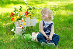 Cute boy in the garden with flowers Royalty Free Stock Photo
