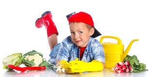Cute boy gardener. Cute preschool boy gardener.  on the white background Royalty Free Stock Image