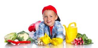 Cute boy gardener Royalty Free Stock Image