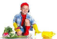 Cute boy gardener. Cute preschool boy gardener.  on the white background Stock Photography
