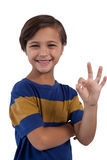 Cute boy gesturing okay hand sign Stock Photos