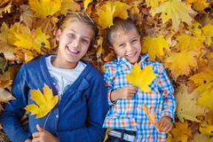 Cute boy and girl in autumn park Stock Photo